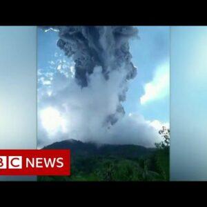 Thousands flee poisonous gas after volcano erupts - BBC News