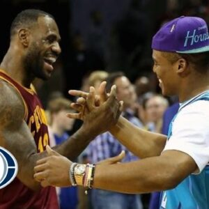 LeBron James and Cam Newton chat courtside   Cavs at Hornets